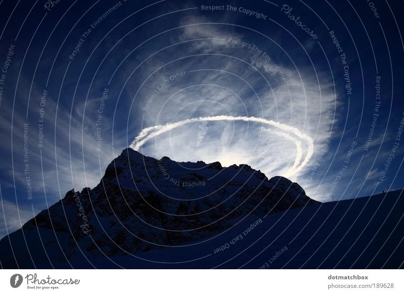 Holy Hill Nature Landscape Sky Clouds Sun Sunlight Winter Beautiful weather Snow Rock Alps Mountain Snowcapped peak Vapor trail Halo Gigantic Strong Blue White