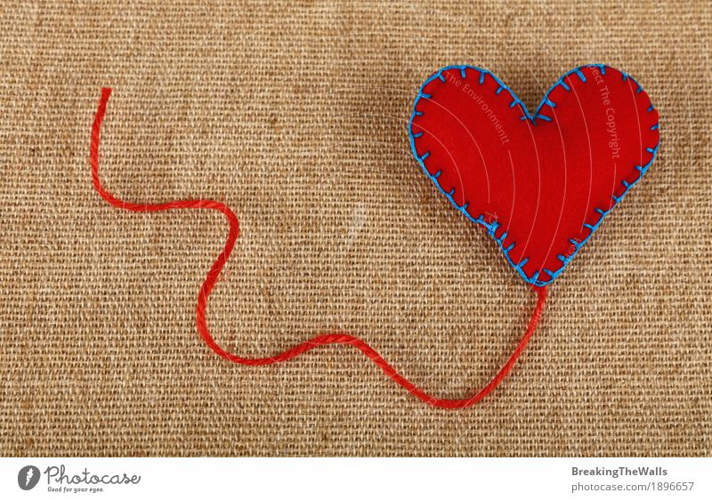 Handmade red felt craft heart with twine on canvas Leisure and hobbies Handicraft Handcrafts Decoration Valentine's Day Mother's Day Craft (trade) Art Cloth