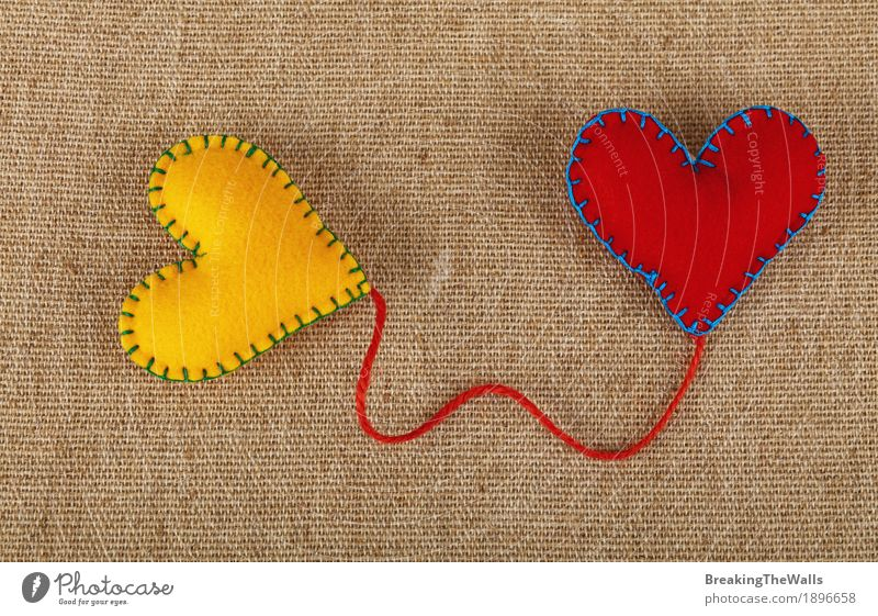 Two felt hearts yellow and red with twine on canvas Leisure and hobbies Handicraft Handcrafts Valentine's Day Wedding Art Cloth Heart Love Together Natural