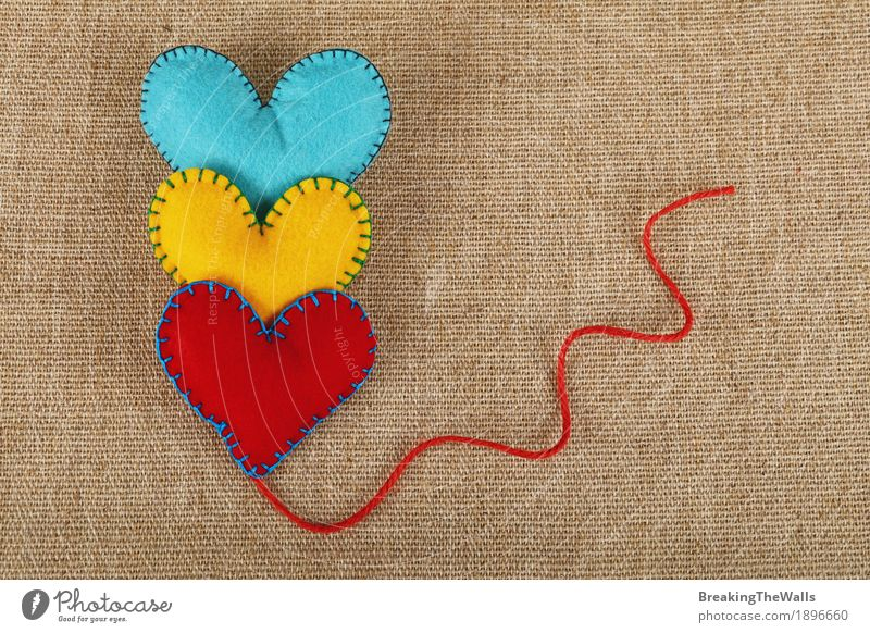 Three stitched felt hearts, yellow, red and blue, with twine Leisure and hobbies Handicraft Handcrafts Valentine's Day Easter Thanksgiving Family & Relations