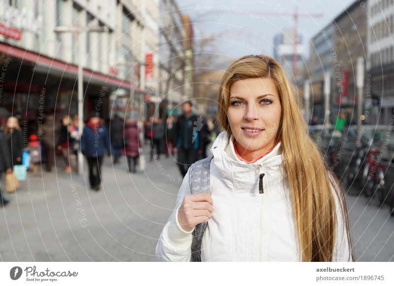 young woman in the city centre Lifestyle Shopping Leisure and hobbies Human being Feminine Young woman Youth (Young adults) Woman Adults 1 Group Crowd of people