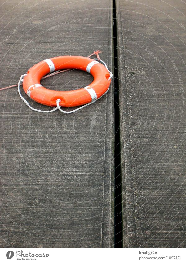 lifebelt Life belt Utilize Lie Round Gray White Determination Safety Fear Threat Help Hope Rescue Survive Orange on the dry Maritime Navigation