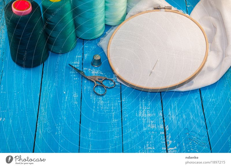 turquoise thread with the fabric in the wooden embroidery frame Design Leisure and hobbies Embroidery Sewing thread Work and employment Craft (trade) Tool