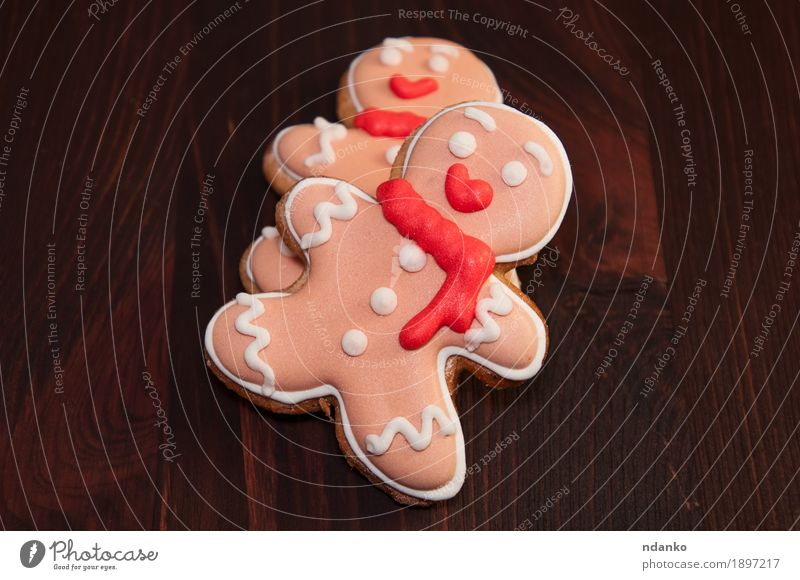 Two edible gingerbread man , top view Man Christmas & Advent Winter Adults Wood Small Feasts & Celebrations Couple Brown Pink Decoration Vantage point Table
