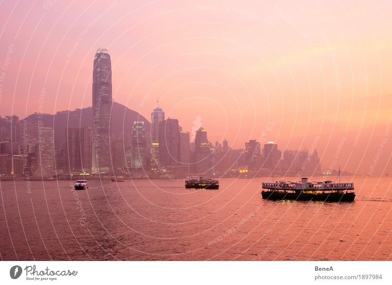 Sunset with boats in front of the Hong Kong skyline Capital city Port City Downtown Skyline Overpopulated High-rise Tourist Attraction Vacation & Travel Town