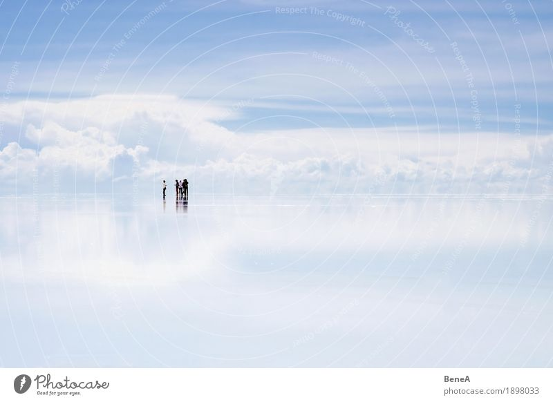 Group of people standing in front of clouds in Uyuni Salt Lake Vacation & Travel Sightseeing Human being Nature Eternity Exotic Freedom Infinity Far-off places