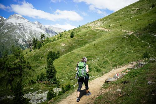 Woman with rucksack goes mountain hiking in Vinschgau, Italy Sports Human being Adults Nature Going Hiking Loneliness Relaxation Leisure and hobbies Joy