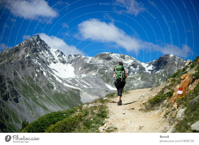 Human being Woman Sky Nature Vacation & Travel Green Sun Landscape Relaxation Mountain Adults Lanes & trails Sports Grass Snow Going