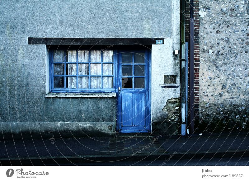 house Village House (Residential Structure) Wall (barrier) Wall (building) Facade Door Mailbox Eaves Living or residing Old Poverty Gloomy Blue Acceptance