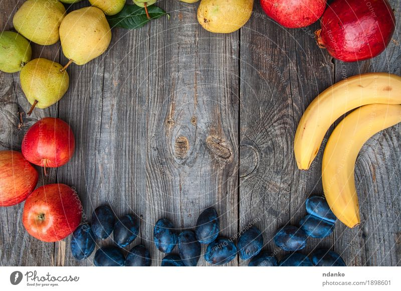 Fresh ripe fruits are laid out on the perimeter Nature Summer Green Healthy Eating Red Yellow Autumn Natural Wood Garden Gray Above Fruit Fresh Vantage point Table
