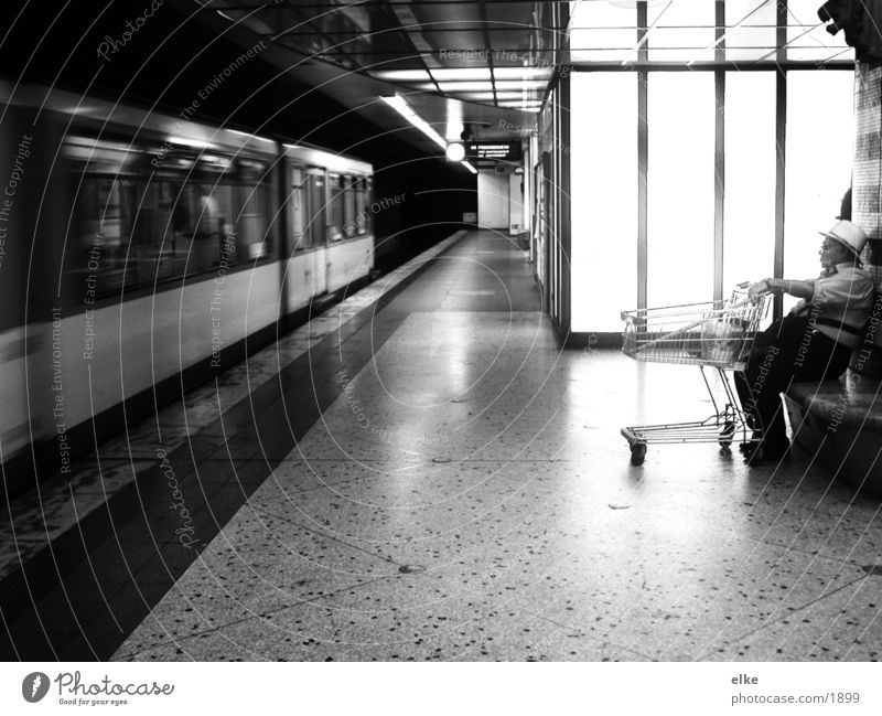 wait for the next Shopping Trolley Man Underground Transport Human being Black & white photo