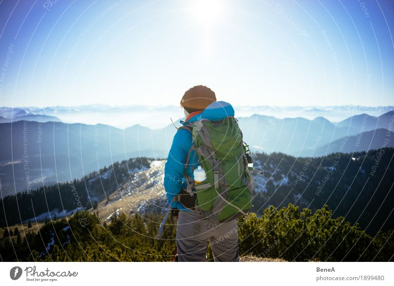 Hiker with rucksack looking over Alps and mountain range Relaxation Vacation & Travel Sports Woman Adults Nature Fitness Discover Leisure and hobbies Alpine