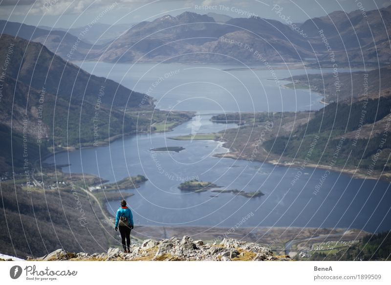 Woman hiking to mountain with view of Loch Leven, Scotland Vacation & Travel Adults Nature Fitness Adventure Discover Experience Leisure and hobbies Horizon
