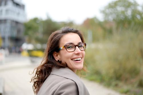 portrait of a woman Joy Happy Contentment Feminine Woman Adults 1 Human being 18 - 30 years Youth (Young adults) Town Brunette Long-haired Laughter Friendliness