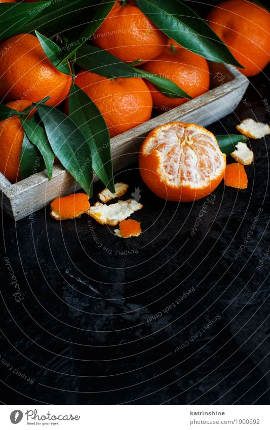 Mandarins with leaves in a box Fruit Dessert Nutrition Blackboard Leaf Dark Bright Delicious Green Decline christmas eat food Gourmet sundried sweet Tasty