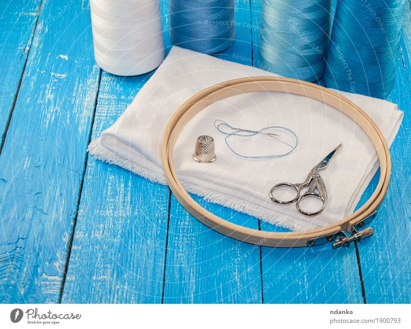 Threads in spools with white cloth for the embroidery Leisure and hobbies Workplace Industry Scissors Group Cloth Wood Blue White thread Sewing row Textiles