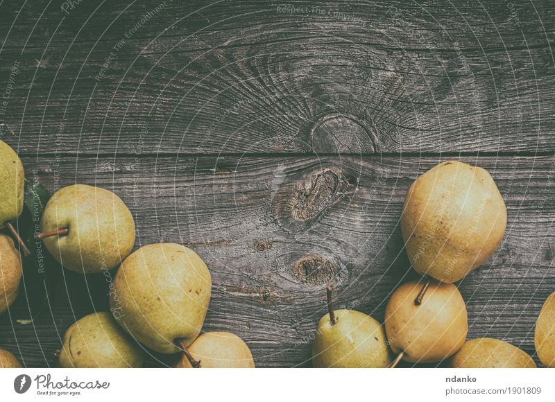 green pears on gray worn wooden background Fruit Pear Vegetarian diet Old Fresh Natural Juicy Yellow Gray Green Edible food many Meal Product ripe Shabby