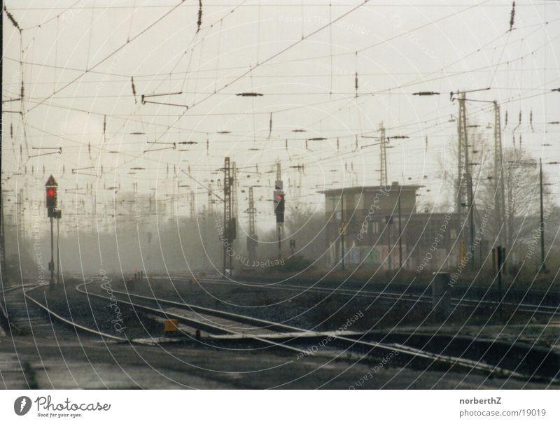 Rain Fog Railroad Technology Railroad tracks Train station Traffic light Electrical equipment