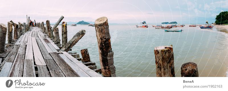 Old wooden jetty and fishing boats in Langkawi Bay, Malaysia Beverage Beach Exotic Nature Vacation & Travel Environment Far-off places Iceland Malaya Jetty