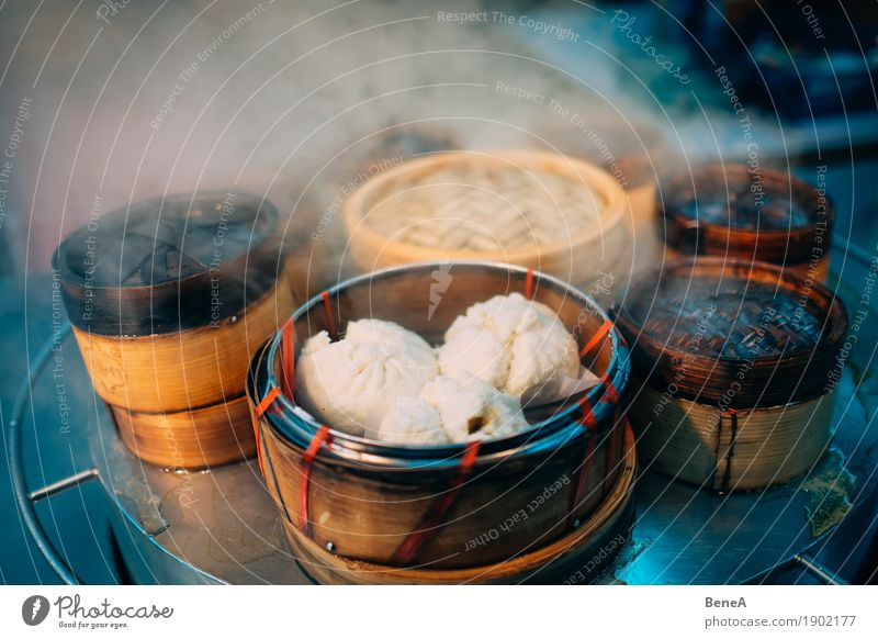Dumplings in bamboo baskets in Asian street cuisine Food Dough Baked goods Nutrition Fast food Finger food Asian Food Fragrance Exotic Vacation & Travel Baozi