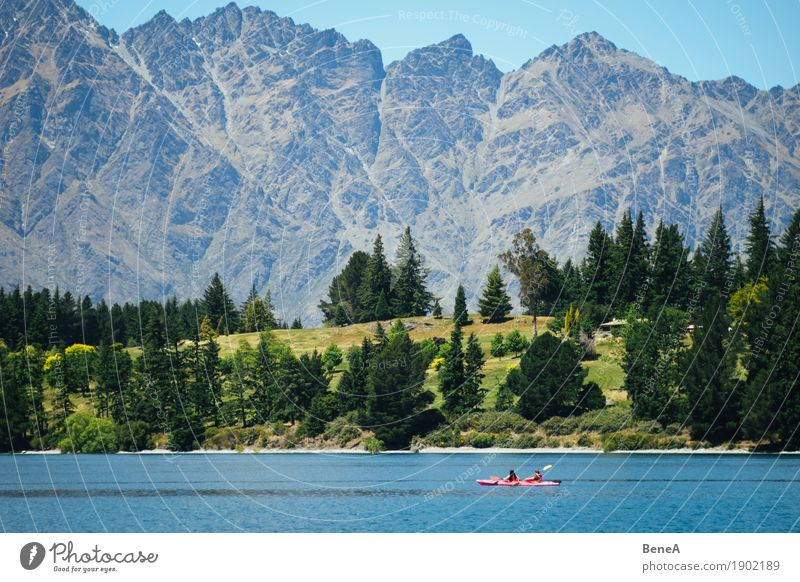 Kayak rider in front of mountain range Remarkables in New Zealand Leisure and hobbies Vacation & Travel Sports Human being Nature Adventure Loneliness