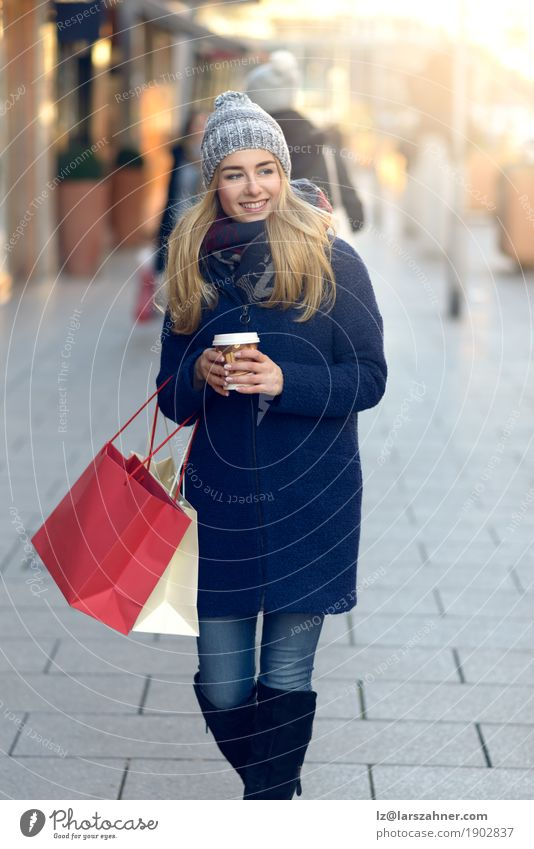 Gorgeous young woman out shopping Coffee Shopping Happy Beautiful Face Winter Woman Adults 1 Human being 18 - 30 years Youth (Young adults) Pedestrian Street