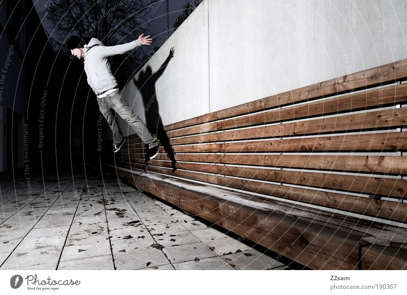 Human being Youth (Young adults) Adults Dark Wall (building) Architecture Movement Jump Wall (barrier) Building Style Elegant Flying Tall Masculine Design