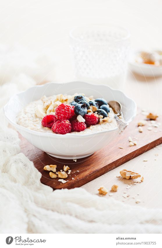 Porridge with fresh fruits porridge overnight oats Oat flakes Healthy Healthy Eating Nutrition Food photograph Breakfast Fruit Raspberry Blueberry Banana Walnut