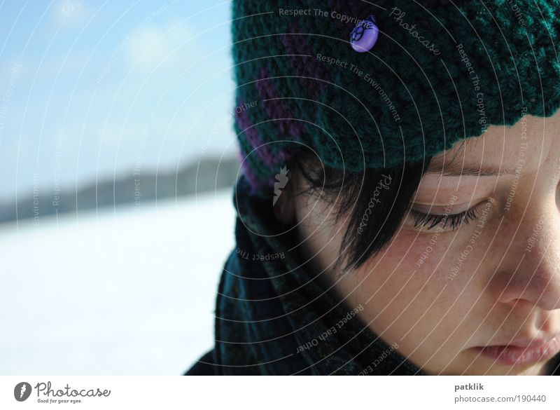 Youth (Young adults) Winter Face Far-off places Feminine Dream Cat Mouth Nose Lips Cap Meditative Beautiful weather Looking Freckles Go under