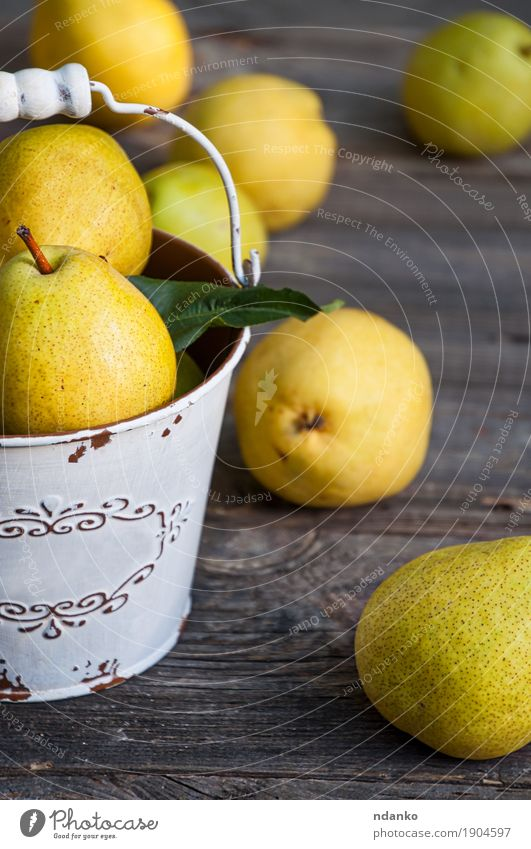 Ripe yellow pears in an iron bucket, gray old wooden surface Nature Old Summer Colour Green Yellow Autumn Natural Wood Gray Fruit Nutrition Fresh Retro Table