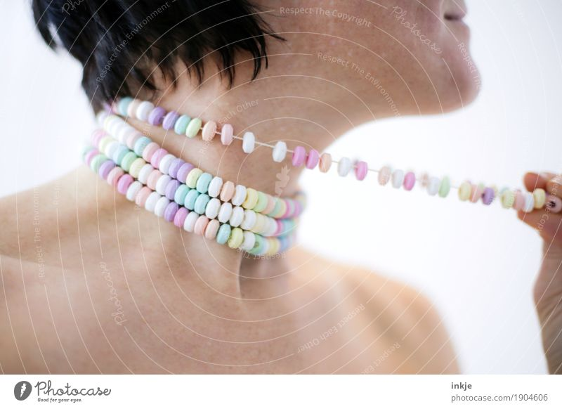Enjoy sweets Candy Nutrition Lifestyle Style Joy Beautiful Healthy Woman Adults Skin Face Shoulder Neck Woman`s neck 1 Human being 30 - 45 years Jewellery