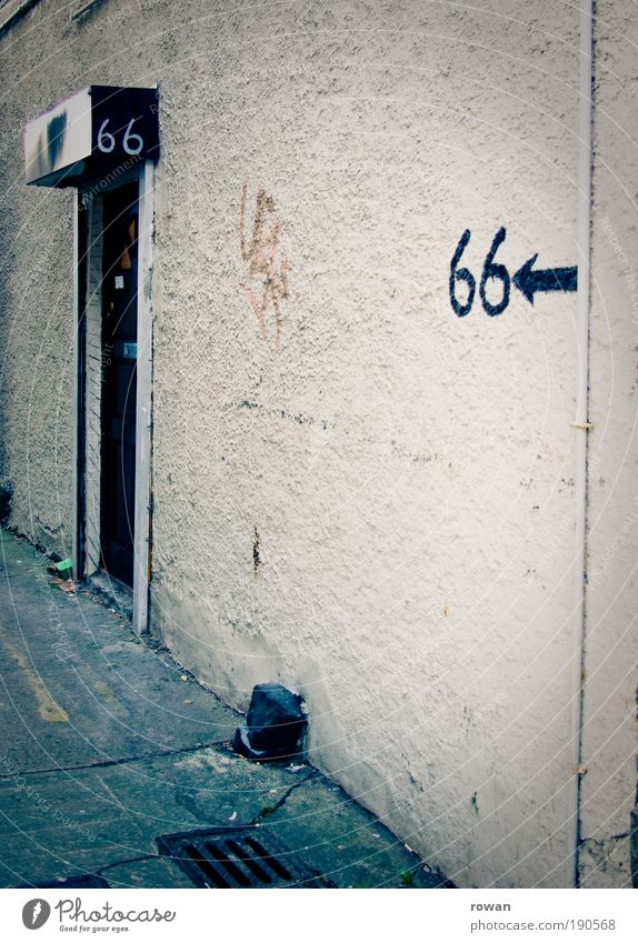 Old House (Residential Structure) Dark Building Graffiti Dirty Architecture Gloomy Digits and numbers Arrow Direction Manmade structures Entrance Shabby Plaster