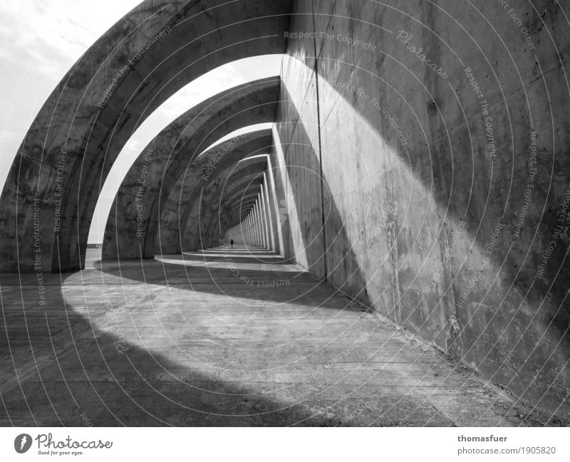 Human being Woman Town White Loneliness Calm Black Adults Architecture Wall (building) Sadness Lanes & trails Building Wall (barrier) Gray Moody