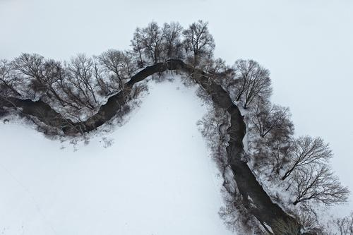 environmental balance Environment Nature Landscape Earth Water Winter Snow Tree Bushes Fluid Cold Above Under Brook Bend Bird's-eye view Calm Freedom Bleak
