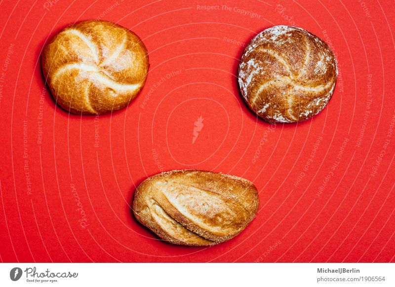 Three different rolls on a red background Food Dough Baked goods Bread Roll Nutrition Red Bakery King Potatoes Wholewheat three Eating Normal Workshop