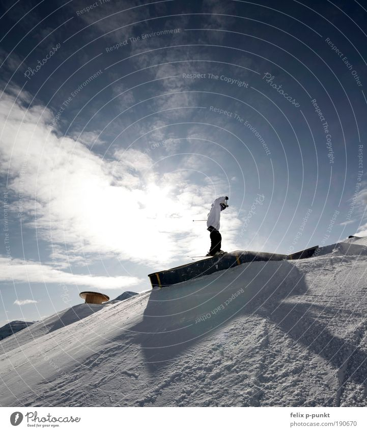 sunslide Lifestyle Tourism Trip Sportsperson Skis Sporting Complex Human being Young man Youth (Young adults) 1 Environment Sky Clouds Sun Sunlight Mountain