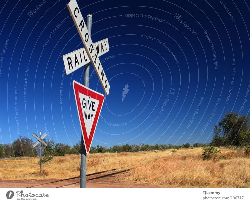 Vacation & Travel Travel photography Railroad tracks Sign Signage Beautiful weather Signs and labeling Australia Blue sky Steppe Intersection Badlands Signal Warning sign Outback Savannah