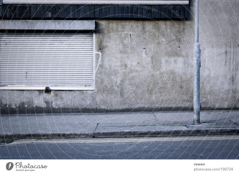 street scene in grey Wall (barrier) Wall (building) Gray Gloomy Empty Going Dark Street Asphalt Lantern Roller shutter Concrete Sadness Closed Sidewalk Black