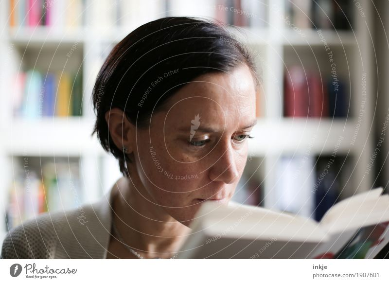 Enjoy time. Lifestyle Leisure and hobbies Reading Bookshelf Woman Adults Face 1 Human being Culture Media Study Interest Colour photo Interior shot Close-up Day