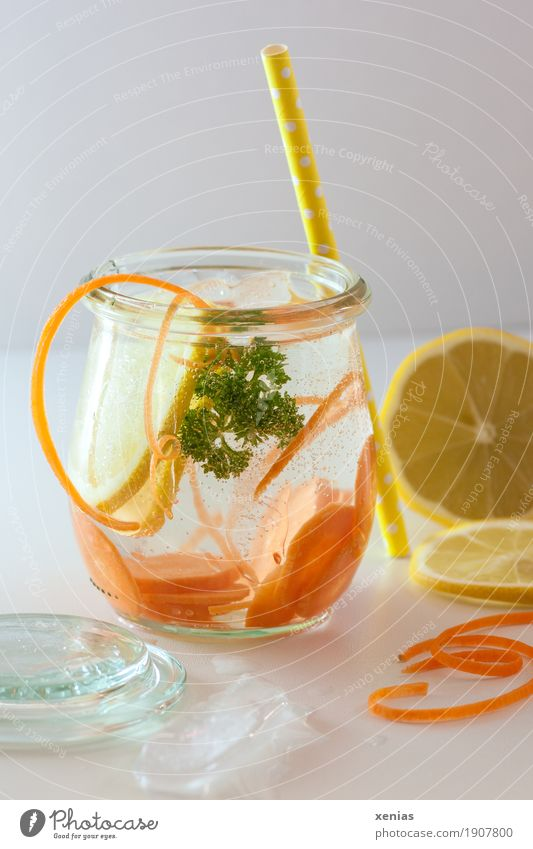 Detox water with carrot, lemon and parsley Vegetable Fruit Carrot Parsley Lemon Organic produce Beverage Drinking Cold drink Drinking water Ice cube Glass Straw