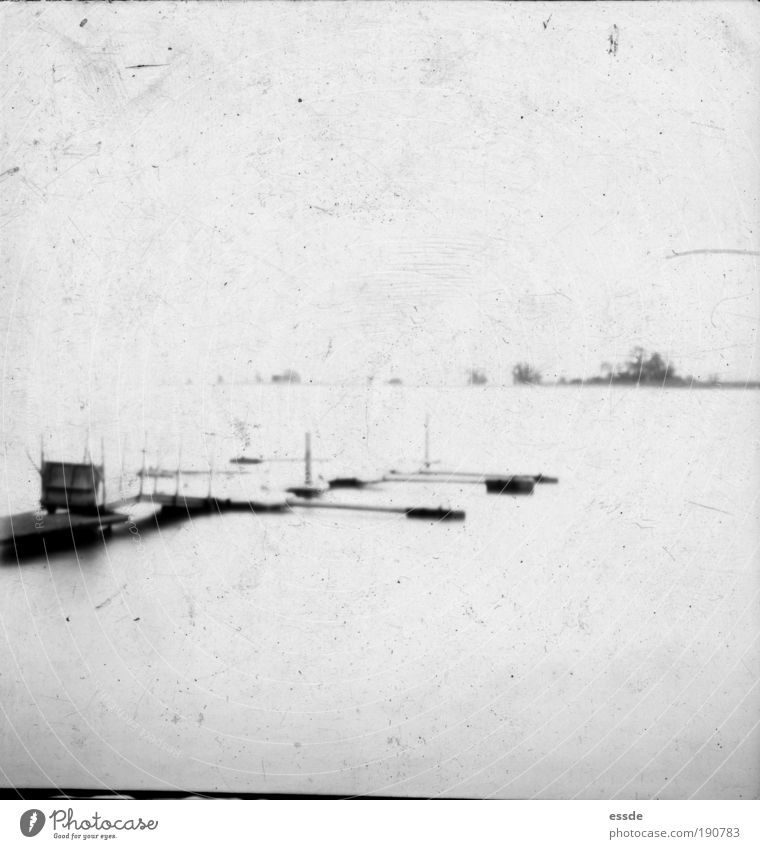 dock Trip Water Lakeside Deserted Harbour Boating trip Old Wait Dirty Simple Infinity Original Black White Secrecy Calm Longing Loneliness Mysterious Nostalgia