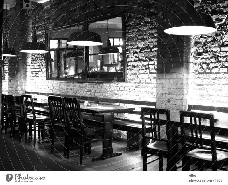 Lamp Wall (building) Table Chair Mirror Café Services Black & white photo