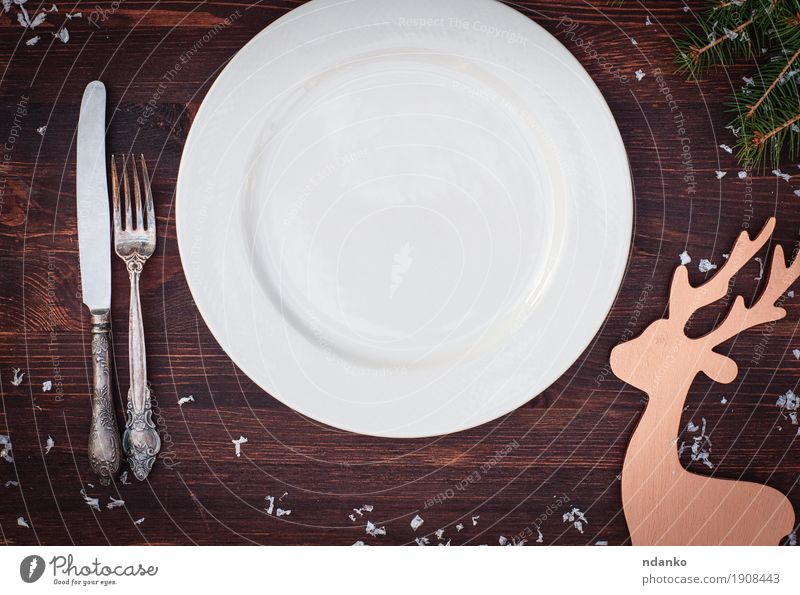 White plate with fork and knife on the wooden table Christmas & Advent White Dish Eating Wood Feasts & Celebrations Brown Above Retro Vantage point Table Places Clean Kitchen Toys Restaurant