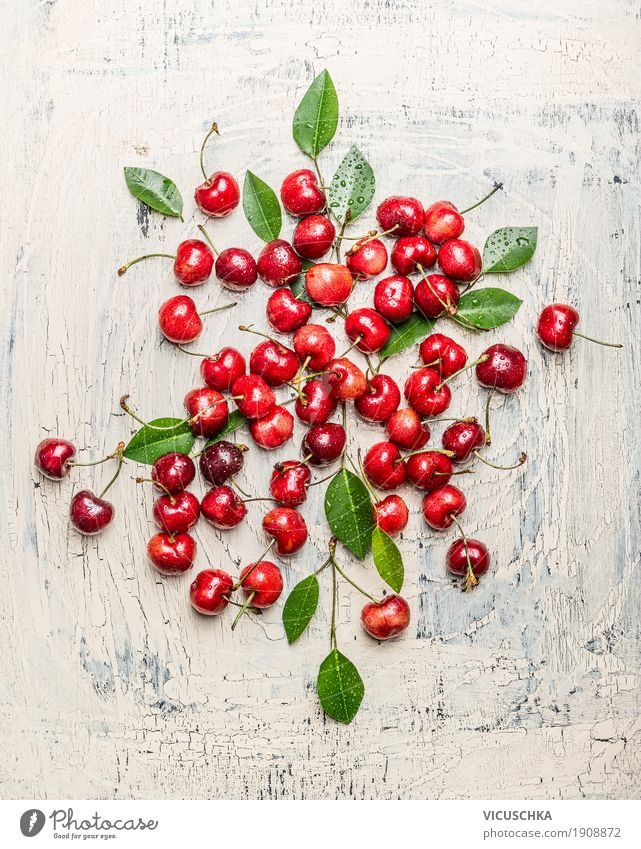 Scattered cherries with green leaves Food Fruit Nutrition Organic produce Vegetarian diet Style Design Healthy Healthy Eating Life Summer Table Nature Garden