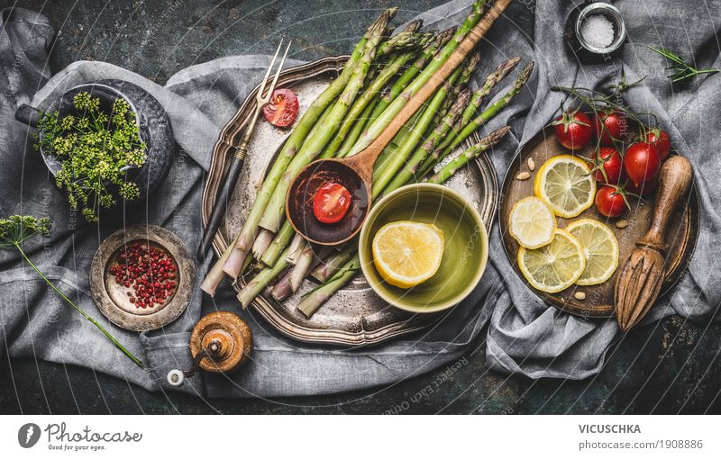 Asparagus and ingredients on a rustic kitchen table Food Vegetable Herbs and spices Cooking oil Nutrition Lunch Dinner Banquet Organic produce Vegetarian diet