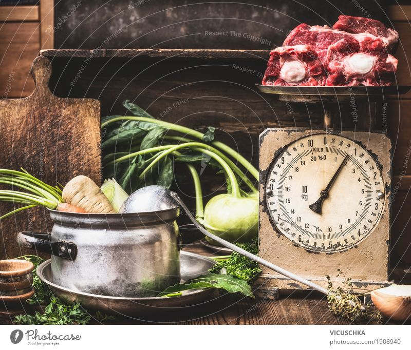 Kitchen table with saucepan, vegetables, old scales and soup meat Food Meat Vegetable Soup Stew Herbs and spices Nutrition Lunch Dinner Organic produce Beverage