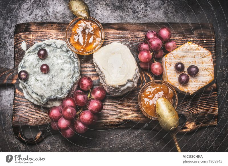 Rustic cheese platter with various cheeses Food Cheese Fruit Nutrition Beverage Style Design Restaurant Yellow Brie Gourmet Snack Vintage Chopping board