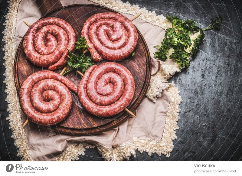 Bratwurst snails on cutting board Food Meat Sausage Nutrition Picnic Style Kitchen Barbecue (apparatus) Design Raw Chopping board Rustic Food photograph BBQ