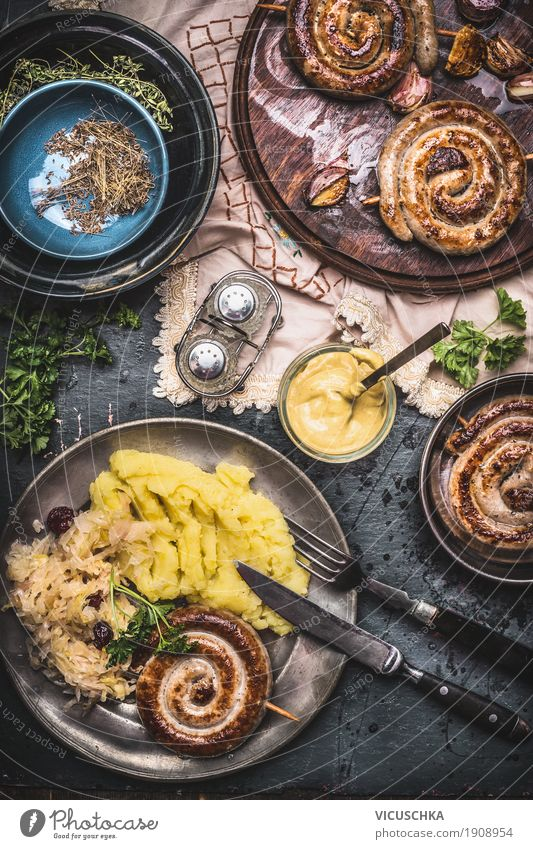Bratwurst with potatoes and sauerkraut Food Sausage Vegetable Nutrition Lunch Dinner Crockery Plate Bowl Cutlery Style Oktoberfest Snowboard