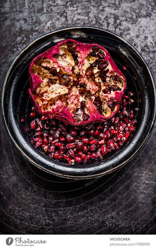 Open pomegranate with seeds in a rustic bowl Food Fruit Nutrition Breakfast Organic produce Vegetarian diet Diet Beverage Bowl Style Design Healthy